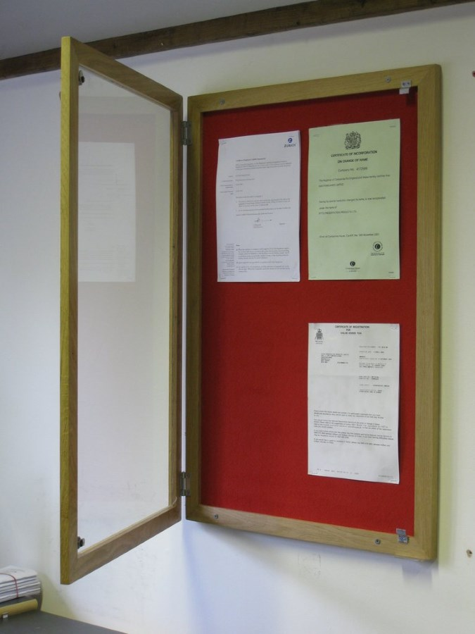 Portable Exhibition Frame : Wood framed lockable felt notice board fire rated