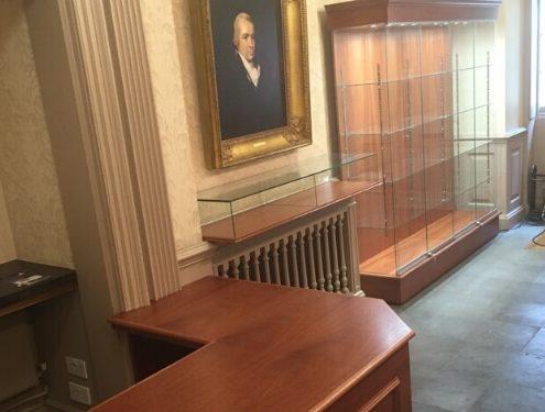 Custom glass display case and reception desk – British Association of Dermatologists