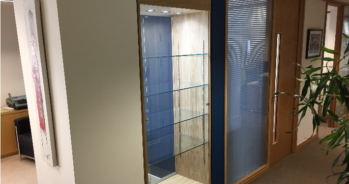 built in custom glass display case - acacia mining