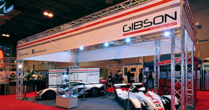 Lighting gantry exhibition stand with print