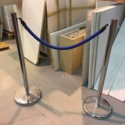 1 Set of chrome posts and blue rope barrier